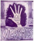 """Mano gigante pintada en el muro con la consigna """"Vote lista 69""""."""